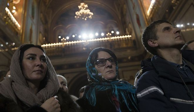 Russian Orthodox believers pray as they attend Mass at the Christ the Saviour Cathedral in Moscow, Russia, early Sunday, Jan. 7, 2018. The Russian Orthodox, like several other Orthodox denominations, observes Christmas on January 7. (AP Photo/Ivan Sekretarev)