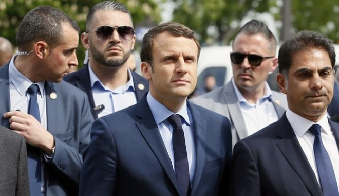 French centrist presidential candidate Emmanuel Macron, center, next to Mourad Franck Papazian, left, co-president of France's Armenian Organizations Coordination Council (CCAF), right, arrives for a ceremony marking 102nd anniversary of the slaying of Armenians by Ottoman Turks in a brief ceremony, Monday April 24, 2017 in Paris. Macron, a centrist with pro-business, pro-European views, will face far-right leader Marine Le Pen in the May 7 runoff of the presidential election. (AP Photo/Francois Mori)