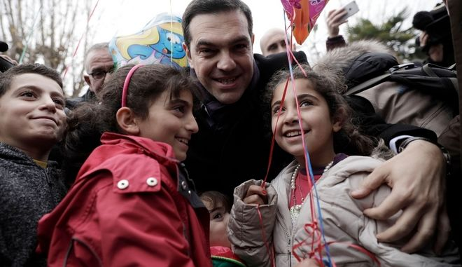 Greek Prime Minister Alexis Tsipras with refugee children in Asterokosmos Christmas park  in Thessaloniki, Greece on January 5, 2017 /            5 , 2017