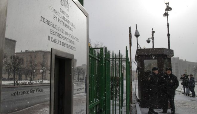 Russian police officers guard an entrance to the British Consulate General, in St. Petersburg, Russia, Saturday, March 17, 2018.  Russia on Saturday announced it is expelling 23 British diplomats and threatened further measures in retaliation in a growing diplomatic dispute over a nerve agent attack on a former spy in Britain. (AP Photo/Dmitri Lovetsky)