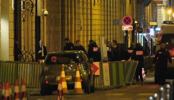 In this image made from video, French police attend the scene outside the Ritz Hotel in Paris, France, after a robbery Wednesday evening Jan. 10, 2018.  Police said Wednesday that five people, at least some armed, entered the luxury Ritz Hotel and made off with goods, likely to be jewels, worth an important sum, and reported that three robbers were arrested and two escaped capture.(Clement Lanot via AP)