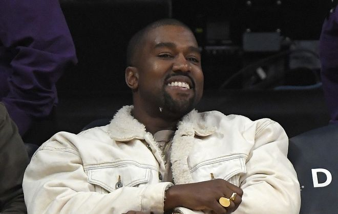 Rapper Kanye West watches during the second half of an NBA basketball game between the Los Angeles Lakers and the Memphis Grizzlies, Sunday, Nov. 5, 2017, in Los Angeles. (AP Photo/Mark J. Terrill)