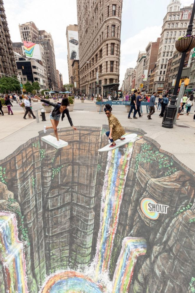 Jordan Andrews, left, and Alexandra Douby takes the plunge into New York Artist Joe Hill's 3-D depiction of the fun you can with color Friday, May 30, 2014 in New York. Photo by Shout.