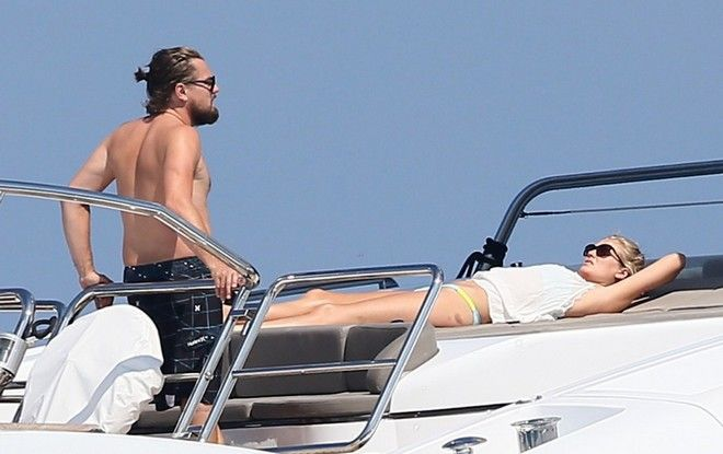 51485734 Actor Leonardo DiCaprio and his girlfriend Toni Garrn enjoy an afternoon on their yacht off the coast of Saint-Tropez, France on July 24, 2014. The couple went for a swim together, then rinsed off on the boat before heading to the top deck to dry off in the sun. Leo is sporting a bit of pudge around his mid section these days... FameFlynet, Inc - Beverly Hills, CA, USA - +1 (818) 307-4813 RESTRICTIONS APPLY: USA ONLY