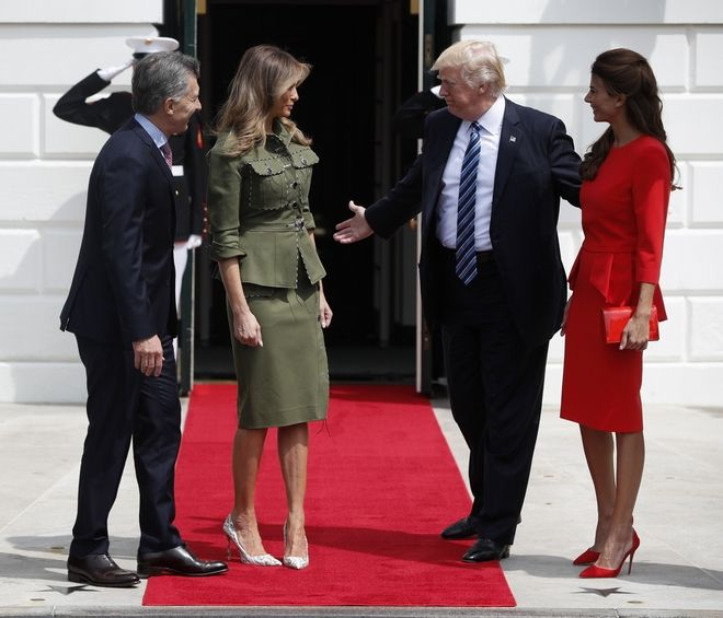 President Donald Trump and first lady Melania Trump greet Argentine President Mauricio Macri and his wife Juliana Awada at the White House in Washington, Thursday, April 27, 2017. (AP Photo/Pablo Martinez Monsivais)