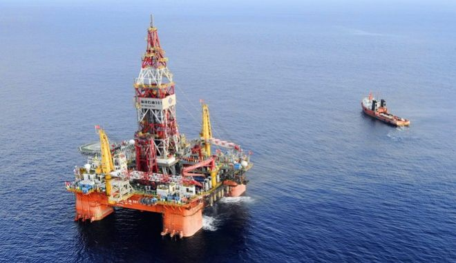 FILE - In this May 7, 2012 file photo released by China's Xinhua News Agency, Haiyang Shiyou oil rig, the first deep-water drilling rig developed in China by the China National Offshore Oil Corporation, is pictured at 320 kilometers (200 miles) southeast of Hong Kong in the South China Sea. Two state-owned companies, China General Nuclear Power Group and China National Nuclear Corp., have announced plans to develop floating nuclear reactors for use by oil rigs or island communities. If they succeed, the achievement would raise concern the reactors might be sent into harms way to support oil exploration in the South China Sea, where Beijing faces conflicting territorial claims by neighbors including Vietnam and the Philippines. (Jin Liangkuai/Xinhua News Agency via AP, File) NO SALES