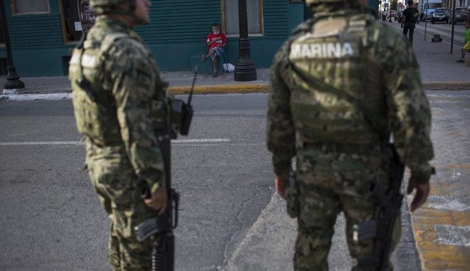 Mexican marines patrol downtown Matamoros, Tamaulipas, Mexico, Wednesday, March 22, 2017, across the border from Brownsville, Texas. (AP Photo/Rodrigo Abd)