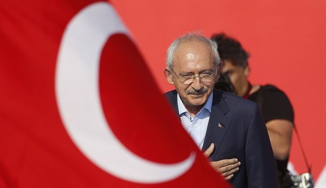 Kemal Kilicdaroglu leader of Republican People's Party (CHP) waves to the crowd during a Democracy and Martyrs' Rally in Istanbul, Sunday, Aug. 7, 2016. More than 1 million flag-waving Turks gathered in Istanbul on Sunday for an anti-coup rally to mark the end of nightly demonstrations since the July 15 abortive military insurrection that left more than 270 people dead. (AP Photo/Emrah Gurel)