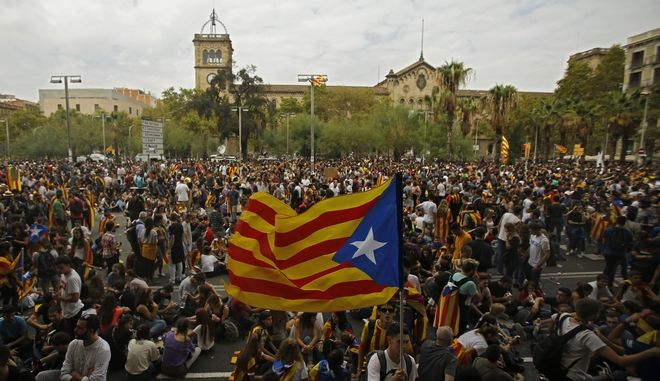 "Demonstrators with ""estelada"", or Catalonia independent flag, gather in protest in Barcelona, Spain, Tuesday Oct. 3, 2017. Labor unions and grassroots pro-independence groups are urging workers to hold partial or full-day strikes and demonstrations throughout Catalonia to protest alleged brutality by police during a referendum on the region's secession from Spain that left hundreds of people injured. (AP Photo/Francisco Seco)"