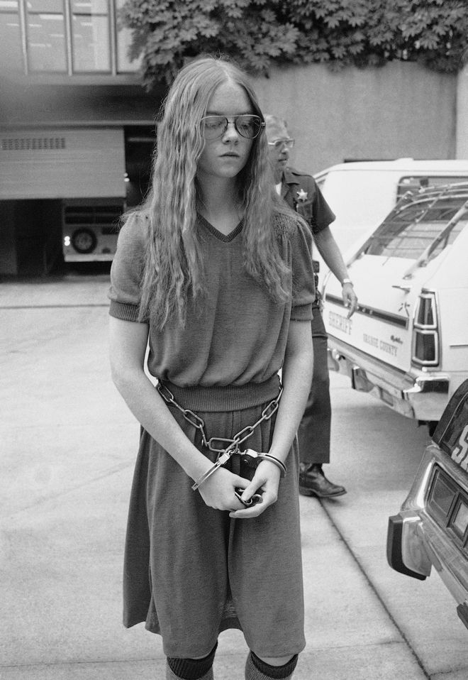 Brenda Spencer, accused in the San Diego elementary school sniping attack that killed two men and wounded eight children and a police officer, leaves court, Oct. 1, 1979, in Santa Ana, Calif. after pleading guilty to the charges. The trial was moved to Santa Ana from San Diego because of heavy publicity the case had received there. (AP Photo/Nick Ut)