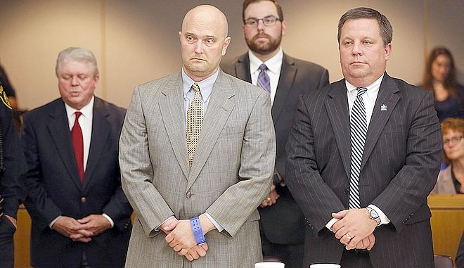 Former Balch Springs Police Officer Roy Oliver, foreground left, stands next to defense attorney Miles Brissette, right, after being sentenced to 15 years in prison for the murder of 15-year-old Jordan Edwards, Wednesday, Aug. 29, 2018, at the Frank Crowley Courts Building, in Dallas. (Rose Baca/The Dallas Morning News via AP, Pool)