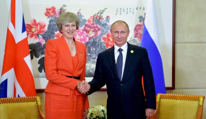 Russian President Vladimir Putin, right, shakes hands with British Prime Minister Theresa May during a bilateral meeting in Hangzhou, China, Sunday, Sept. 4, 2016, ahead of the G20 Leaders Summit. (Alexei Druzhinin/Pool Photo via AP)