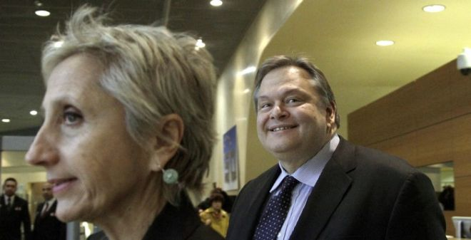 Greek Finance Minister Evangelos Venizelos, right, leaves after a meeting at EU headquarters in Brussels on Monday, Nov. 7, 2011. Greece's two biggest parties resumed talks Monday to agree on who should be the country's new prime minister, after reaching a historic power-sharing deal to accept a massive financial rescue package and prevent imminent bankruptcy. Fellow European governments will want concrete progress by the evening, when eurozone finance ministers meet to discuss the possibility of unfreezing bailout loans that had been kept on hold while the country sorted its political turmoil. (AP Photo/Virginia Mayo)