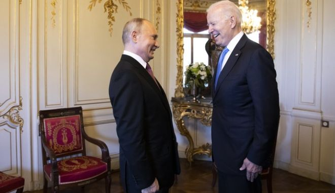 Russian president Vladimir Putin, left, talks with US president Joe Biden, right, during the US - Russia summit in Geneva, Switzerland, Wednesday, June 16, 2021. (Peter Klaunzer/Swiss Federal Office of Foreign Affairs via AP)
