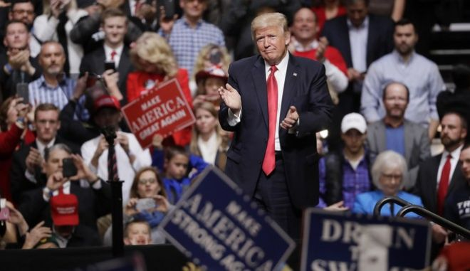 President Donald Trump acknowledges the crowd after speaking at a rally Wednesday, March 15, 2017, in Nashville, Tenn. (AP Photo/Mark Humphrey)