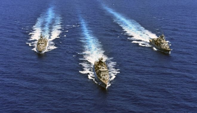 """In this photo provided by the Greek Defense Ministry, warships take part in a military exercise in Eastern Mediterranean sea, on Tuesday, Aug. 25, 2020. Germany's foreign minister appealed to NATO allies Greece and Turkey to deescalate military tensions in the eastern Mediterranean, warning Tuesday that """"any spark, however small, could lead to a disaster."""" (Greek Defense Ministry via AP)"""