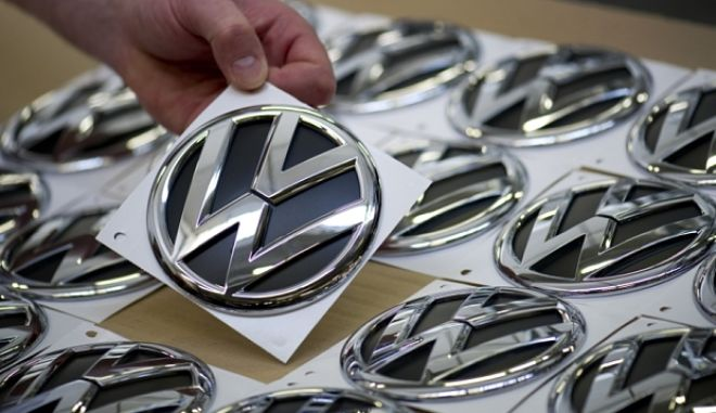 FILES - A Volkswagen employee picks up a logo to be fitted on the VW Tiguan and Touran models on March 7, 2012 in Wolfsburg, central Germany. Shares in German auto giant Volkswagen fell more than 13 percent on the Frankfurt stock exchange on September 21, 2015 after it emerged at the weekend that some of its diesel cars in the US had been fitted with software that gave false emissions data.     AFP PHOTO / ODD ANDERSENODD ANDERSEN/AFP/Getty Images