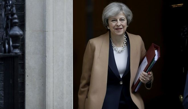 British Prime Minister Theresa May leaves 10 Downing Street in London, to attend Prime Minister's Questions at the Houses of Parliament, Wednesday, March 15, 2017. (AP Photo/Matt Dunham)