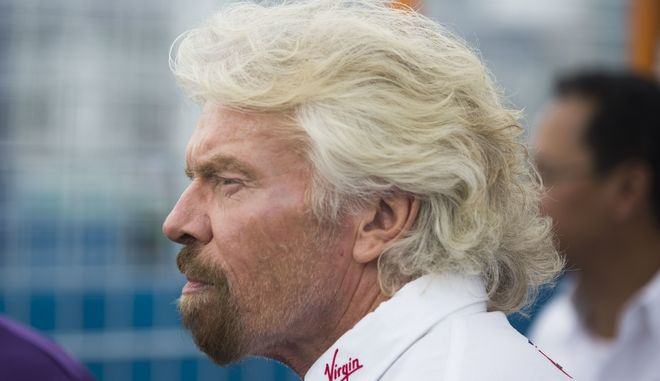 Virgin Group founder Richard Branson approaches the winner's circle after team driver Sam Bird won the New York City ePrix a Formula E all-electric auto race Saturday, July 15, 2017, in the Brooklyn borough of New York. (AP Photo/Michael Noble Jr.)
