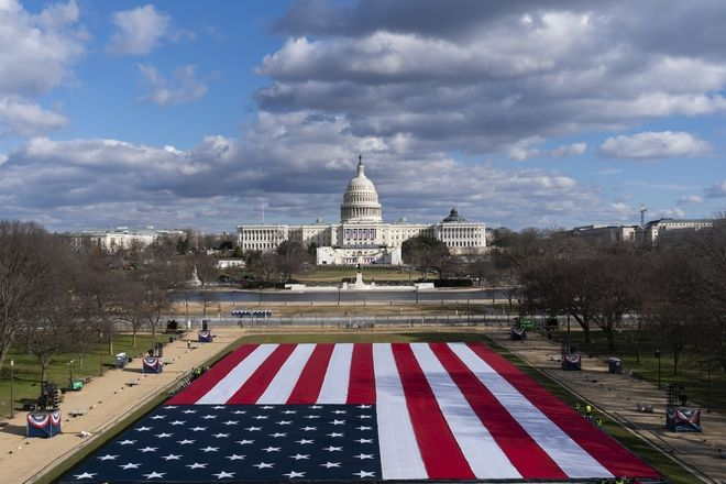 A large American Flag is are placed on the National Mall, with the U.S. Capitol behind, ahead of the inauguration of President-elect Joe Biden and Vice President-elect Kamala Harris, Monday, Jan. 18, 2021, in Washington. (AP Photo/Alex Brandon)