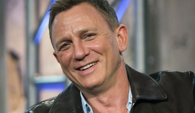 """FILE - In this Nov. 5, 2015 file photo, Daniel Craig participates in AOL's BUILD Speakers Series to discuss the James Bond film """"Spectre"""", at AOL Studios in New York. Craig told the crowd Friday, Oct. 7, 2016, at the New Yorker Festival that playing 007 is """"the best job in the world."""" He said that if he were to stop playing the role, he """"would miss it terribly."""" (Photo by Charles Sykes/Invision/AP, File)"""