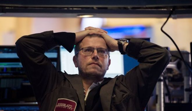 A trader works on the floor at the closing bell of the Dow Industrial Average at the New York Stock Exchange on February 5, 2018 in New York.  Wall Street stocks endured a brutal session Monday, with the Dow seeing one of its steepest ever one-day point drops, as the heady bullishness of early 2018 gave way to extreme volatility. / AFP PHOTO / Bryan R. Smith        (Photo credit should read BRYAN R. SMITH/AFP/Getty Images)