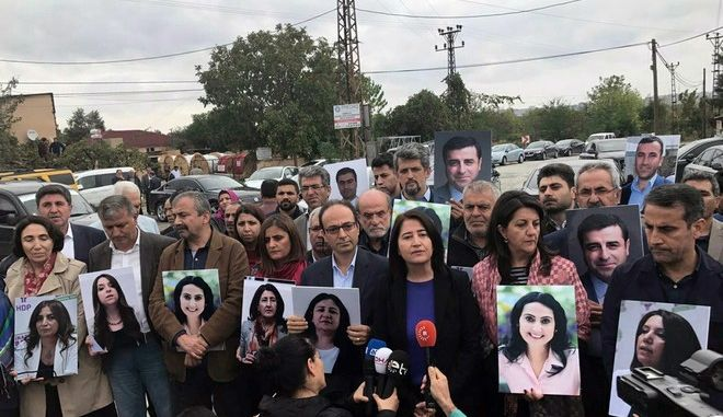 Lawmakers from pro-Kurdish Peoples's Democracy Party, or HDP, hold photographs of jailed HDP legislators, outside the prison in western Turkish city of Edirne, Turkey, Sunday, Oct. 1, 2017. The HDP members did not attend the opening session of Turkey's parliament Sunday where President Recep Tayyip Erdogan addressed the parliamentarians in Ankara. ( AP Photo )