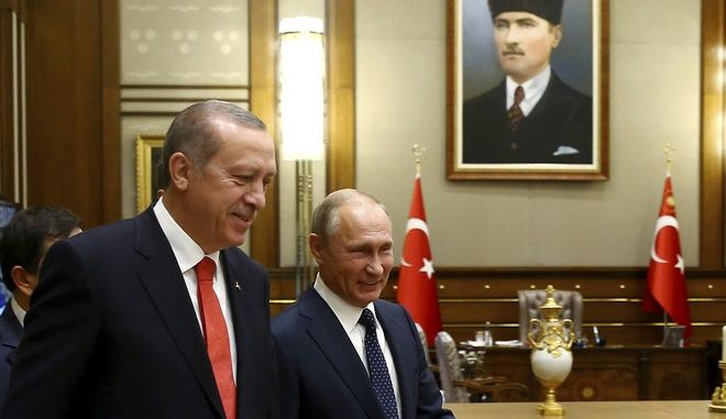 Turkey's President Recep Tayyip Erdogan, left, and Russian President Vladimir Putin walk following a meeting in Ankara, Turkey, Thursday, Sept. 28, 2017. Russian President Vladimir Putin is Ankara for talks with Erdogan on developments in Iraq and Syria, and Turkey's decision to purchase a Russian-made missile defense system. (Kayhan Ozer/Presidency Press Service Pool via AP)