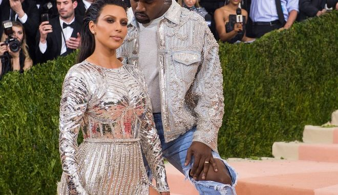 "Kim Kardashian and Kanye West arrive at The Metropolitan Museum of Art Costume Institute Benefit Gala, celebrating the opening of ""Manus x Machina: Fashion in an Age of Technology"" on Monday, May 2, 2016, in New York. (Photo by Charles Sykes/Invision/AP)"