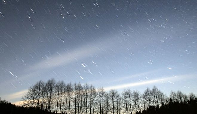 Stars in the sky are seen over a forest near a village of Litovka, 150 km (93 miles) west of Minsk, Belarus, early Wednesday, April 23, 2008. (AP Photo /Sergei Grits)