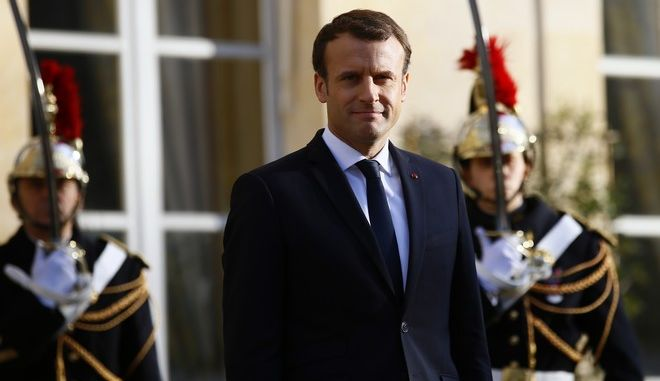 French President Emmanuel Macron waits for Hungarian President Janos Ader, at the Elysee Palace prior to their meeting, in Paris, Tuesday, Dec. 12, 2017. More than 50 world leaders are gathering in Paris for a summit that Macron hopes will give new momentum to the fight against global warming, despite U.S. President Donald Trump's rejection of the Paris climate accord. (AP Photo/Francois Mori)