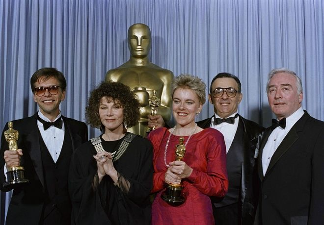 Don Haig, left, Brigitte Berman, center, Milton Justice, right, and Joseph Feury stand with actress Lee Grant, second from left, after receiving Oscars for Best Achievement in Documentary Features, March 30, 1987, Los Angeles, Calif. Ms. Berman and Haig were honored for Artie Shaw: Time is All Youve Got; while Justice and Feury were honored for Down and Cut in America. (AP Photo/Lennox McLendon)