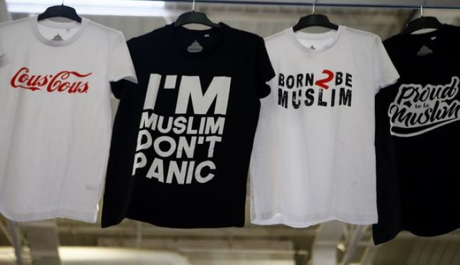 Shirts are displayed inside an exhibition hall at the France Muslim Annual Fair in Le Bourget, north of Paris, Saturday, April 15, 2017. Tens of thousands of Muslims are expected at the three-day event this weekend organized by the ultra-conservative Union of Islamic Organizations of France. It includes merchant stalls, Quran readings, prayers and speeches by leading Muslim figures as Muslims of France want to make sure their voices are heard in France's presidential elections. (AP Photo/Francois Mori)