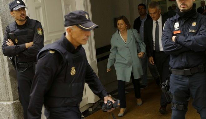 Ex-speaker of the Catalonia parliament Carme Forcadell leaves the Spain's Supreme Court in Madrid, Thursday, Nov. 2, 2017. Supreme Court has suspended the questioning of six Catalan lawmakers who are under investigation for rebellion following the region's declaration of independence. (AP Photo/Francisco Seco)