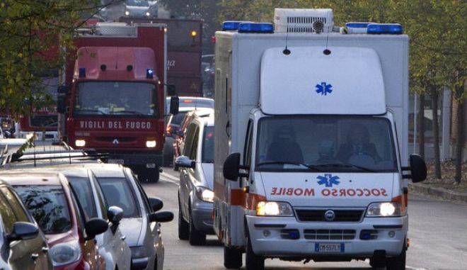 An ambulance carrying an Italian doctor who has tested positive for the Ebola virus makes its way to the Lazzaro Spallanzani National Institute for Infectious Diseases in Rome, Tuesday, Nov. 25, 2014. The Italian health ministry says an Italian doctor working in Sierra Leone has tested positive for the Ebola virus and he has been transferred to Rome for treatment. The ministry said in a statement that the doctor, who works for the non-governmental organization Emergency, will be taken Monday for treatment at the Lazzaro Spallanzani National Institute for Infectious Diseases in Rome. It is Italy's first confirmed case of Ebola. (AP Photo/Riccardo De Luca)