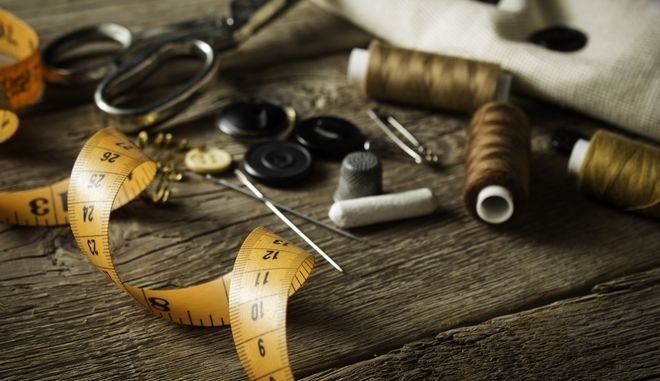 19273579 - sewing accessories on wooden background