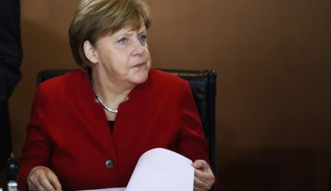 FILE - In this May 3, 2017 photo German Chancellor Angela Merkel attends the weekly cabinet meeting of the German government at the chancellery in Berlin. A pair of upcoming German state elections could show whether the center-left Social Democrats can win back the momentum they need to deny conservative Chancellor Angela Merkel a fourth term. Sundays vote in Schleswig-Holstein and the May 14 election in North Rhine-Westphalia, Germanys most populous state, are the last tests at the ballot box before a national election in September.  (AP Photo/Markus Schreiber, file)