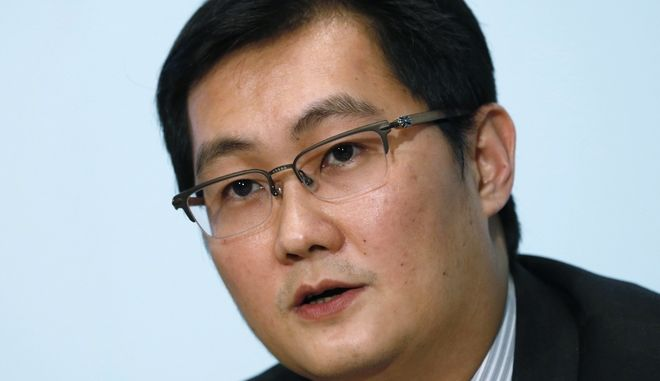 Pony Ma Huateng, Chairman and CEO of Tencent Holdings Ltd., speaks during a press conference to announce his companies' annual results in Hong Kong Wednesday, March 19, 2014. Mainland internet giant, Tencent, said profits rose 22 percent last year to HK$15.5 billion (US$ 2 billion). (AP Photo/Kin Cheung)