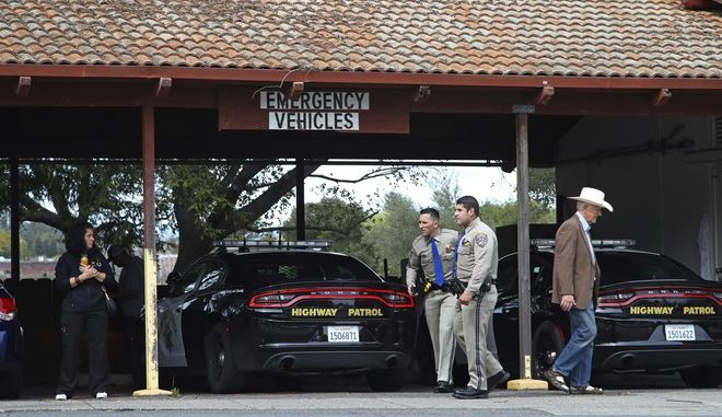 California Highway patrolmen arrive at the Veterans Home of California in Yountville, Calif., on Friday March 9, 2018. A gunman took at least three people hostage at the largest veterans home in the United States on Friday, leading to a lockdown of the sprawling grounds in California, authorities said. (AP Photo/Ben Margot)