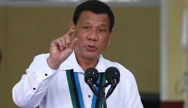 Philippine President Rodrigo Duterte gestures as he addresses troops during change of command and tribute to retiring Philippine Armed Forces Chief Gen. Eduardo Ano at Camp Aguinaldo in suburban Quezon city northeast of Manila, Philippines Thursday, Oct. 26, 2017. President Duterte lauded Ano for his role in liberating the besieged city of Marawi in southern Philippines by the IS-linked militants. (AP Photo/Bullit Marquez)