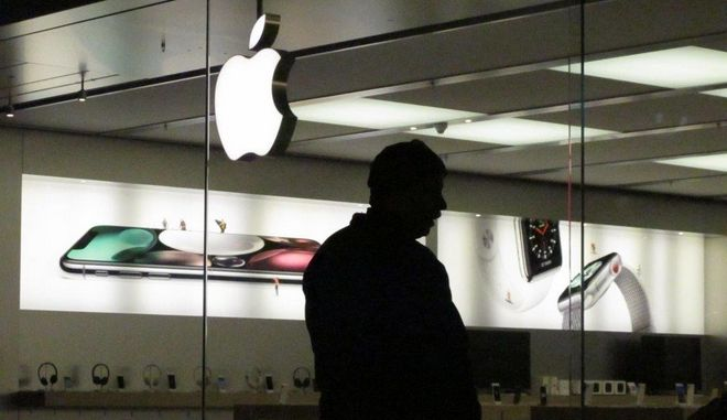 Paul Kain waits for an Apple store to open Friday, Nov. 24, 2017, at a mall in Anchorage, Alaska. Kain, of Seward, Alaska, was among those hitting the stores for Black Friday shopping the day after Thanksgiving. He was planning to buy a coveted iPhone X at the Apple store. (AP Photo/Rachel D'Oro)