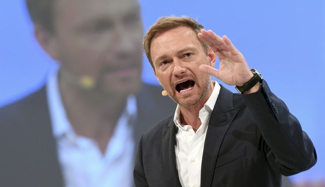 FILE - In this Sept. 17, 2017 file photo Free Democratic Party's (FDP) chairman Christian Lindner speaks during the federal party conference of the FDP in Berlin, Germany. Lindner, 38, has worked hard to make the Free Democratic Party _ the traditional kingmaker of post-World War II German politics _ a relevant political force again after voters, unimpressed by its lackluster performance as junior partner in Chancellor Angela Merkels second-term government, deserted it in 2013. (Ralf Hirschberger/dpa via AP, file)