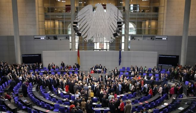 Parliamentarians queue to cast their votes after a debate of the German parliament Bundestag on the gay marriage in Berlin, Germany, Friday, June 30, 2017. (AP Photo/Markus Schreiber)