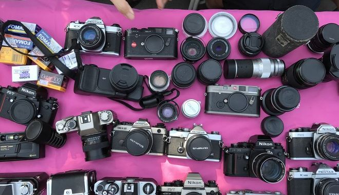 """In this Sunday, Feb. 12, 2017, photo, vintage Leica, Olympus, Nikon, Canon, and Pentax cameras and lenses at an """"Analog Fair"""" in Bangkok, Thailand. With the popularity of film camera photography returning, companies have continued to produce color and black and white film, and the eagerly awaited return of Kodak slide film has been announced. (AP Photo/Charles Dharapak)"""