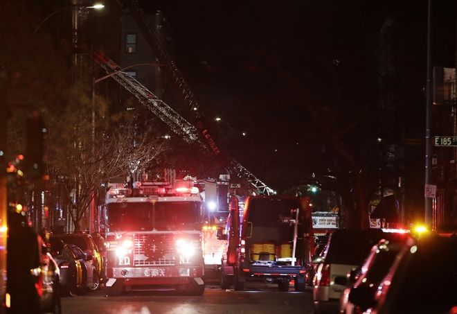 Firefighters respond to a deadly fire Thursday, Dec. 28, 2017, in the Bronx borough of New York. (AP Photo/Frank Franklin II)