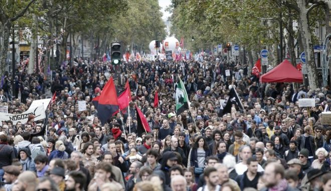 Demonstrators take the streets during a march to protest against President Emmanuel Macron's economic policies, in Paris, France, Tuesday, Oct. 10, 2017. A nationwide strike by French public sector workers on Tuesday was affecting schools, hospitals and public services and causing disruptions in domestic air traffic. (AP Photo/Thibault Camus)
