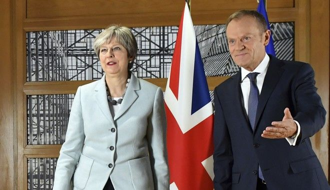 British Prime Minister Theresa May, left, walks with European Council President Donald Tusk prior to a meeting at the Europa building in Brussels on Friday, Dec. 8, 2017. British Prime Minister Theresa May, met with EU officials early Friday morning following crucial overnight talks on the issue of the Irish border. (AP Photo/Geert Vanden Wijngaert)