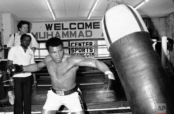 Muhammad Ali throws a left at a sandbag during workout at a Tokyo gym on Wednesday, June 23, 1976. The world heavyweight boxing champion meets Japanese pro wrestler Antonio Inoki in the world's Martial Arts Championship in Tokyo on Saturday. (AP Photo/Nick Ut)