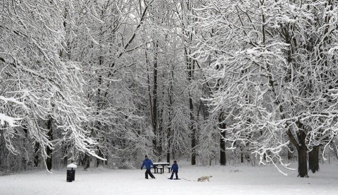 Snow covers Ironbridge, England, Sunday Dec. 10, 2017, as heavy snow falls across parts of Britain. Snow is causing travel disruptions across central England and northern Wales, grounding flights, shutting down roads and causing traffic accidents. (Nick Potts/PA via AP)
