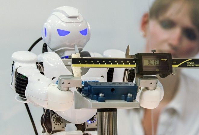 A robot manufactured wih 3d components measures at the stand of Q-Tech Roding GmbH during the international fairs FabCon 3.D and Rapid.Tech at Messe Erfurt in Erfurt, Germany, Tuesday, June 20, 2017. 206 exhibitors from all over the world present the latest products and applications in the fields of additive manufacturing and 3D printing until June 22, 2017. (AP Photo/Jens Meyer)